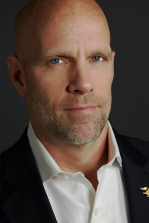 Former Navy SEAL Errol Doebler in a white shirt with a black jacket.