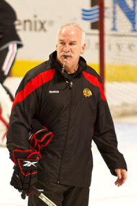 NHL Coach Joel Quenneville out on the ice in a black jacket.