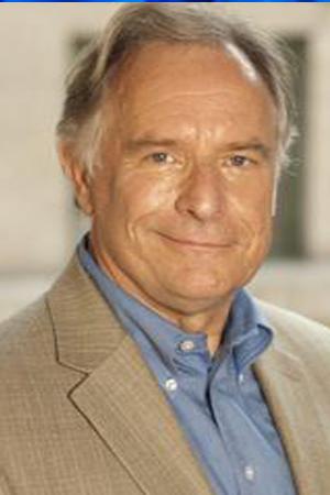 Futurist John Krubski in a brown jacket and a blue shirt.