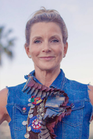 Karen Phelps Moyer in a denim jacket with the sleeves cut off.