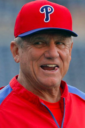 Phillies Coach Larry Bowa wearing a red and blue Philadelphia uniform, the classic colors.