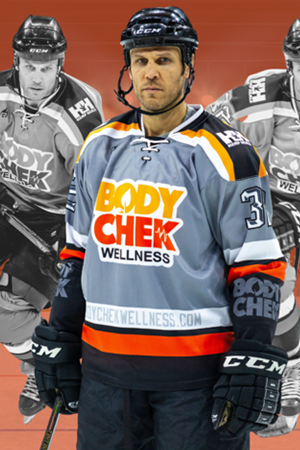 NHL Player Riley Cote sporting hockey gear branded with his company, Body Check Wellness