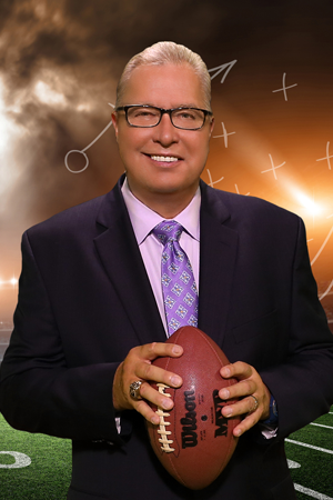 """Former NFL and current CEO Ron """"Jaws"""" Jaworski holding a football."""