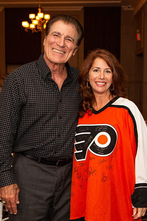 Philadelphia Eagles player Vince Papale with Mollie Plotkin in a Philadelphia Flyers Jersey