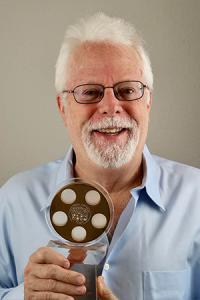 Foley Artist John Roesch holding one of his golden reel awards.