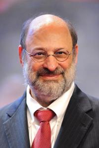 Keynote Speaker Stuart Diamond in a black jacket and red tie.