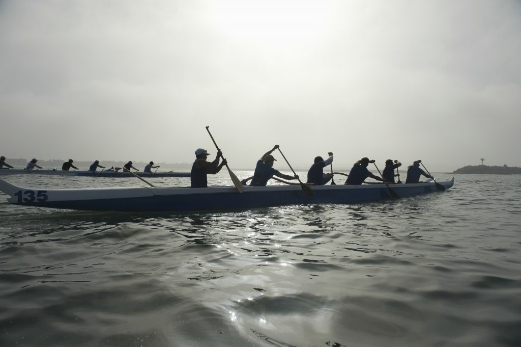 Athletes working together in the water