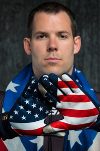U.S. Olympian Johnny Quinn with an American flag draped around his shoulders.