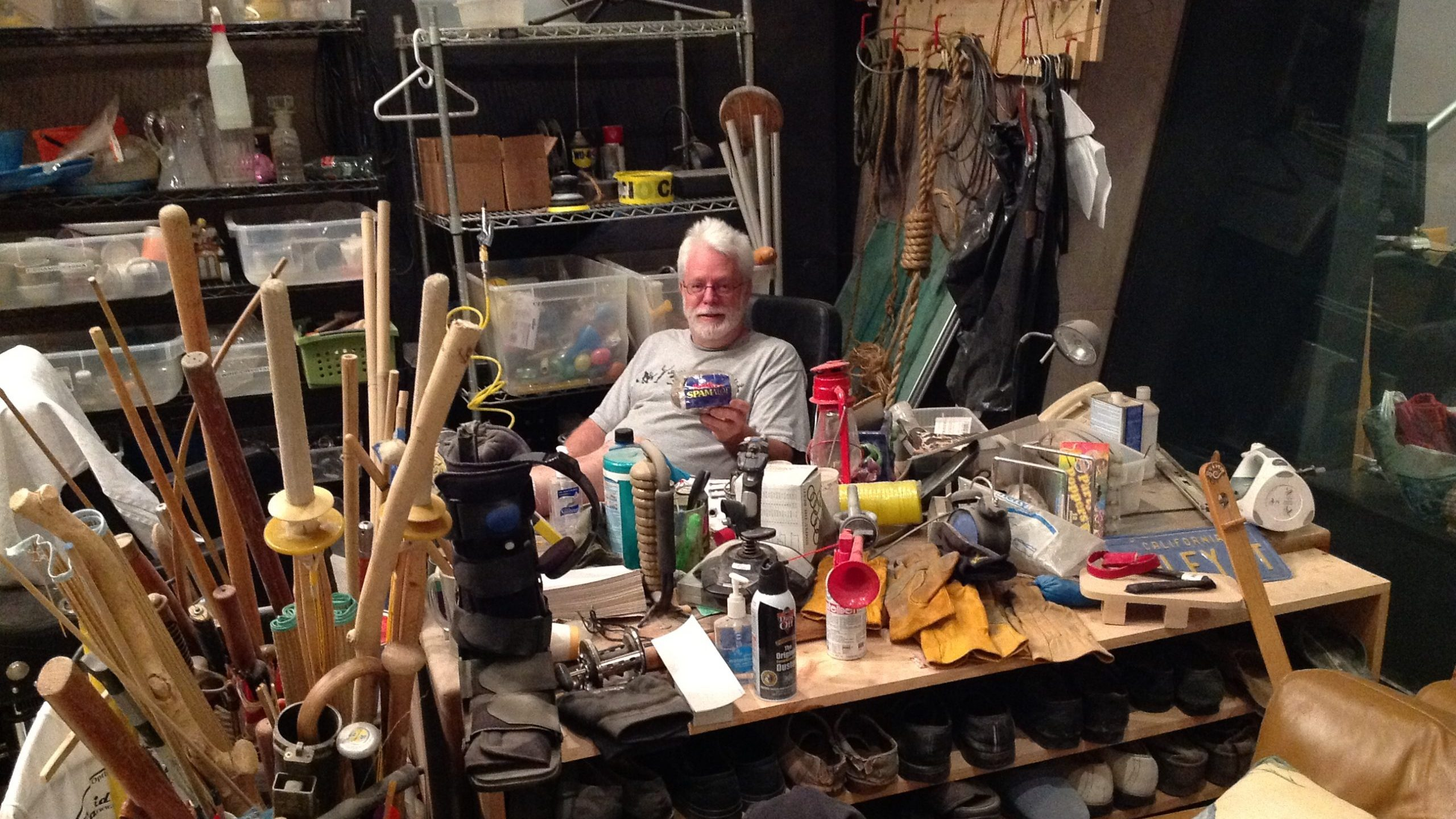 Foley Artist John Roesh sitting behind his desk surrounded by instruments