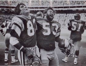 Vince Papale with the Philadelphia Eagles, smiling and laughing with his teammate.