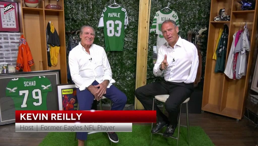 Vince Papale and Kevin Reilly sitting in chairs across from each other.